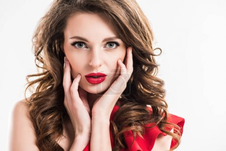 stylish seductive girl touching face with hands and looking at camera isolated on white