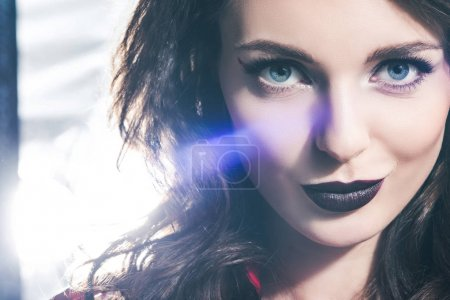 headshot of beautiful girl with dark lips looking at camera