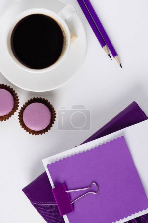 Photo for Top view of workspace with coffe cup and cupcakes - Royalty Free Image
