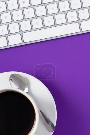 Photo for Top view of workspace with computer keyboard and coffee cup - Royalty Free Image