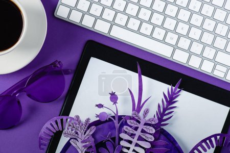 Photo for Top view of workspace with computer keyboard and coffee cup decorated with paper flowers - Royalty Free Image