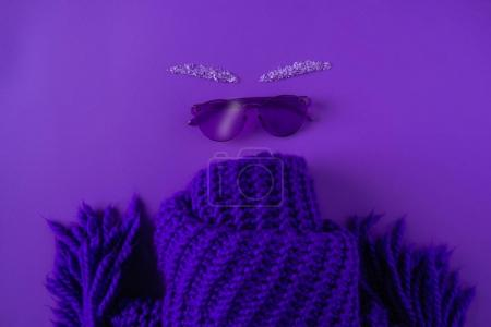 top view of glasses and scarf isolated on purple