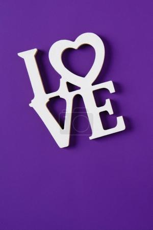 Photo for Top view of word love isolated on purple, valentines day concept - Royalty Free Image