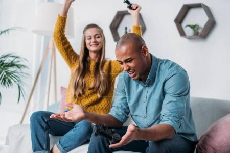 girlfriend winning video game in african american boyfriend