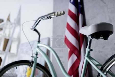 bicycle and usa flag in light apartment