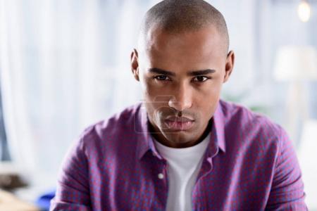 serious african american man looking at camera