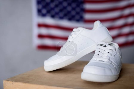pair of new white shoes on usa flag background