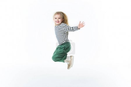 action shot of little child jumping isolated on white