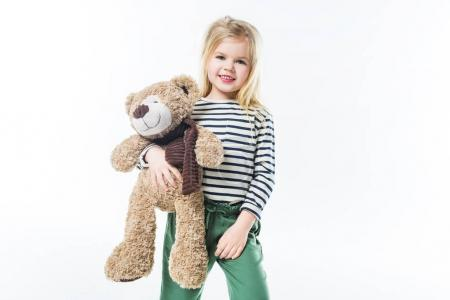adorable little child with teddy bear isolated on white