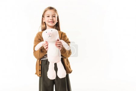 happy little child with soft toy bunny isolated on white