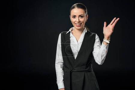 beautiful smiling businesswoman gesturing isolated on black