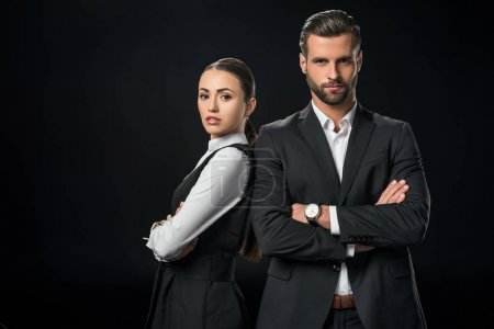 confident businesspeople with crossed arms, isolated on black