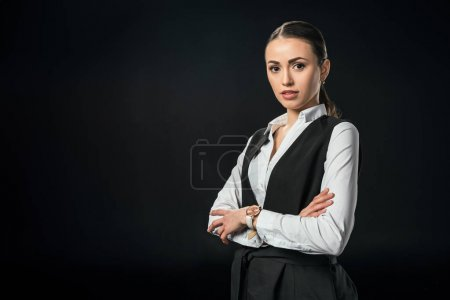 Photo for Young beautiful businesswoman with crossed arms, isolated on black - Royalty Free Image