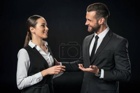 cheerful businesspeople discussing work, isolated on black
