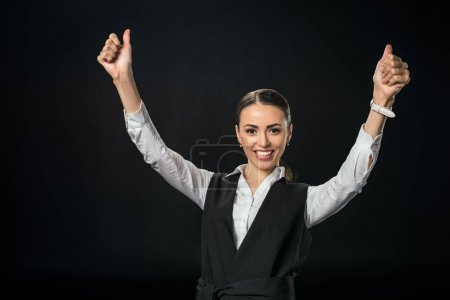 young cheerful businesswoman gesturing and celebrating success, isolated on black