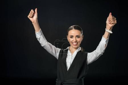 Photo pour Jeune femme d'affaires gaie gesticuler et célébrer le succès, isolé sur noir - image libre de droit