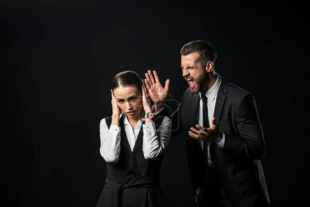 angry boss yelling at businesswoman, isolated on black