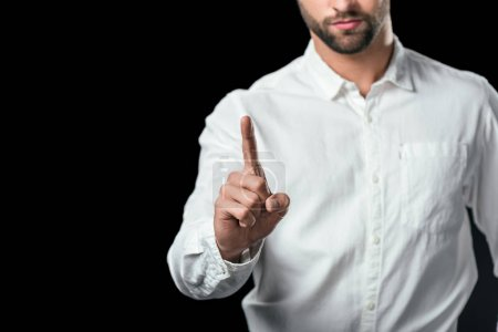 cropped view of businessman pointing up, isolated on black