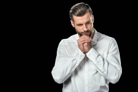 Photo for Nervous businessman in white shirt, isolated on black - Royalty Free Image