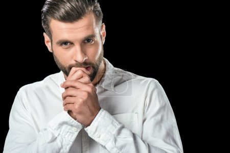 Photo for Handsome nervous businessman in white shirt, isolated on black - Royalty Free Image