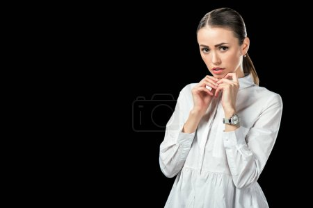 Photo for Attractive nervous businesswoman, isolated on black - Royalty Free Image