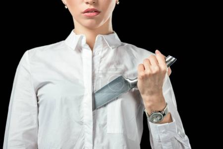 cropped view of businesswoman with knife, isolated on black