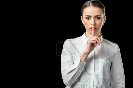businesswoman showing silence symbol, isolated on black