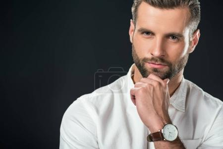Photo for Portrait of handsome pensive businessman in white shirt, isolated on black - Royalty Free Image