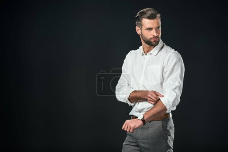 Photo for Handsome businessman in white shirt, isolated on black - Royalty Free Image