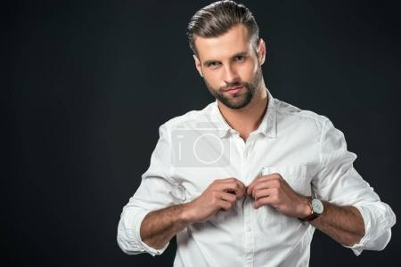 handsome man wearing white shirt, isolated on black