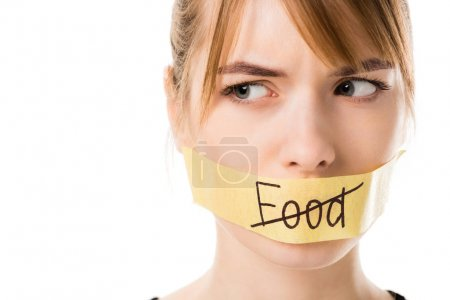 Photo for Young woman with stick tape with striked through word food covering mouth isolated on white - Royalty Free Image