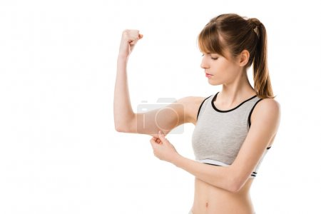 young slim woman showing biceps isolated on white