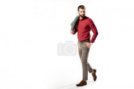 stylish man with jacket in hand walking  isolated on white