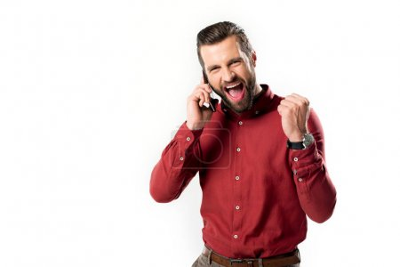 portrait of excited man talking on smartphone isolated on white