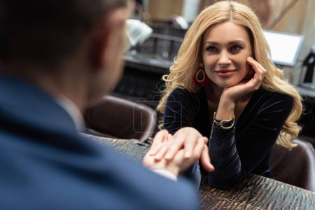 couple having date at restaurant and holding hands