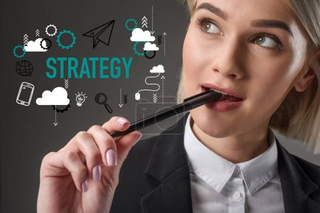 portrait of beautiful young businesswoman with pen, strategy concept