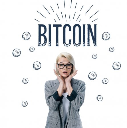 beautiful shocked businesswoman posing in formal wear, bitcoin symbol isolated on white