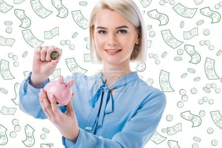 portrait of smiling businesswoman with piggy bank and coin in hands, falling dollar banknotes isolated on white
