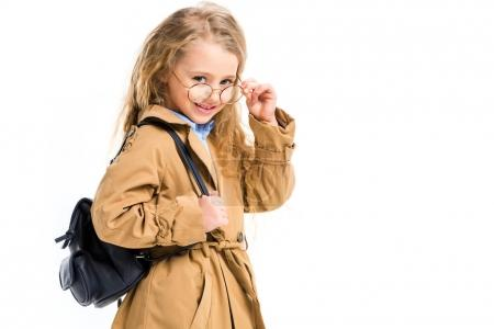 Photo for Portrait of smiling kid in trench coat holding glasses isolated on white - Royalty Free Image