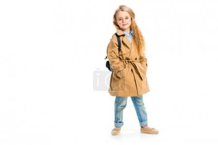 Photo for Child in glasses wearing beige trench coat and holding bag isolated on white - Royalty Free Image