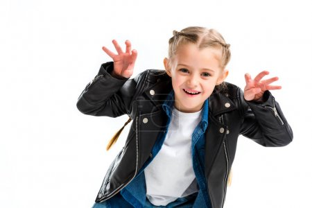 Stylish child with pigtails wearing leather jacket doing scaring gesture isolated on white