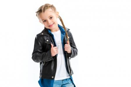 Little child holding her leather jacket isolated on white