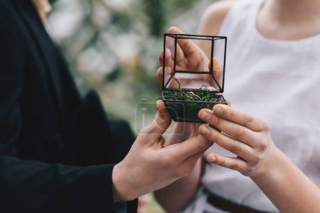 Photo for Cropped shot of young couple holding jewelry box with wedding rings - Royalty Free Image
