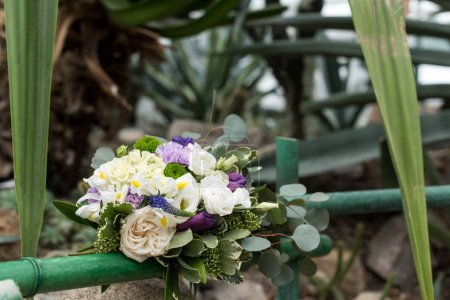 close-up view of beautiful elegant wedding bouquet in botanical garden
