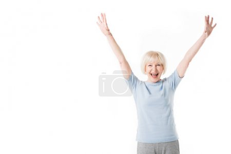 Senior woman standing with arms up isolated on white