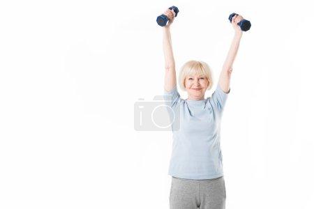 Senior sportswoman training with dumbbells isolated on white
