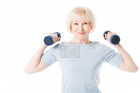 Senior sportswoman training with dumbbells isolated on white