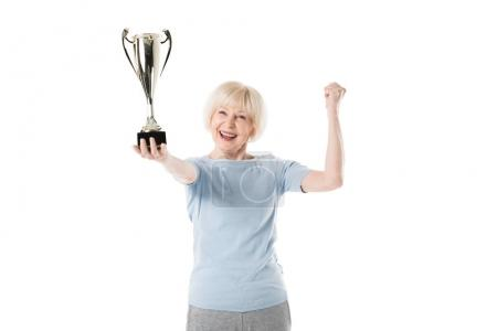 Senior sportswoman holding trophy in hand isolated on white