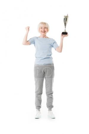 Senior sportswoman with trophy isolated on white