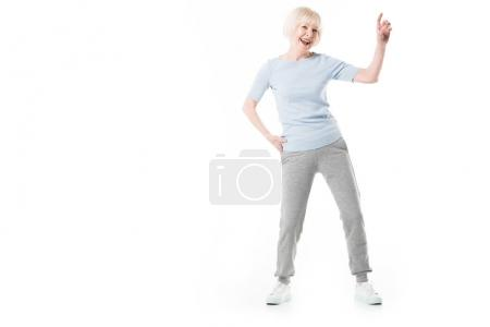 Senior sportswoman gesturing by finger isolated on white